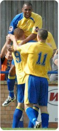 Gareth Sheldon,Owen Story and Ryan Beswick celebrate the opening goal